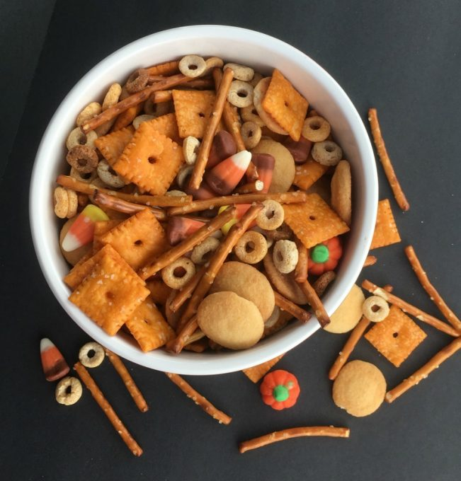 Scare up this Halloween Snack Mix Recipe for your kids Halloween Parties--no tricks, just treats!